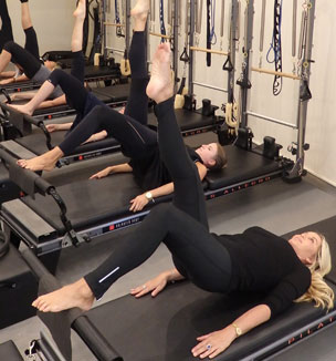 Pilates group class - tower lifts